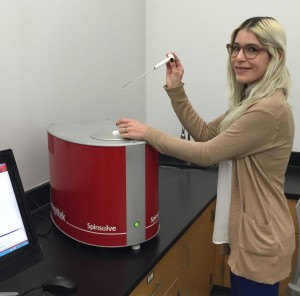 Learning about NMR at Long Beach City College, sophomore Patricia Romine with the Magritek Spinsolve Benchtop NMR.