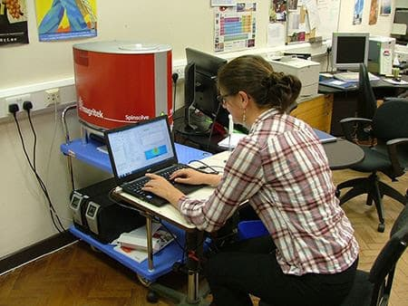 Dr Nicola Rogers is a post doc in the Kenwright group using the Magritek Spinsolve to make relaxation measurements on lanthanide complexes at Durham University. For ease of use, it is mounted on a trolley making it easy to move from lab to lab.